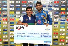 Mr Sushil Kumar World Champion Wrestler Presents the Star Sports Champion of the Match Award to Harbhajan Singh of Mumbai Indians during the 2nd Qualifying match of the Pepsi Indian Premier League between The Rajasthan Royals and the Mumbai Indians held at the Eden Gardens Stadium in Kolkata on the 24th May 2013