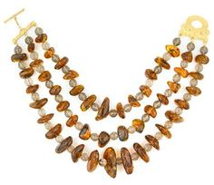 Tony Duquette (American, 1914-1999), 'Symbolizing Longevity and Time Wisely Spent', 1990s. An amber chunk, briolite cut smoky quartz bead and vermeil necklace, length 17in (43cm). Sold for $1,464