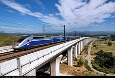 """We are on the Mediterranean HST (LGV Méditerranée in French) also called LN5 i.e. """"Ligne Nouvelle 5"""" (New Line number 5). It was opened in June 2001. The picture shows the 1730m / 5676 ft long Ventabren Viaduct located north of Aix-en-Provence. The speed limit is 320kph / 200 mph on a 41km section between Avignon and Aix en Provence. But that section ends further north of Ventraben. On that bridge the trains run around 250-270kph/155-168mph."""
