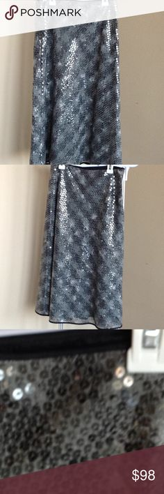Sequined Philippe Adec skirt. Black and gray Sequined black and gray skirt hidden zip closure on the side. Black trimming on the waist and hem. Like new. Philippe Adec Skirts Maxi