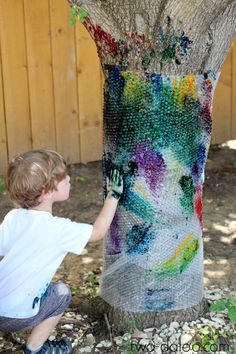 Rainbow finger-painted bubble wrap tree - a fun process art activity combining art, nature, and sensory play. Outdoor Activities For Kids, Toddler Activities, Preschool Activities, Rainbow Activities, Outside Activities, Outdoor Learning, Motor Activities, Summer Activities, Reggio Emilia