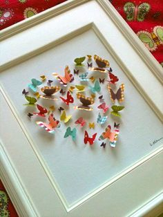 Butterfly cutouts on framed canvas.
