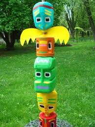 "totem pole with coffee ""cans"""
