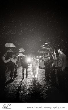 What to do if it rains on your wedding day.  Wedding Photos in the rain