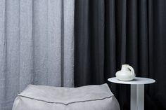 Curtain in grey Madrid and nearly black Dries both from Astrid.