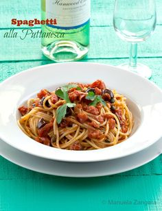 The #recipe for a classic Southern #Italian dish: #Spaghetti alla #Puttanesca, made with tomatoes, olives and capers!