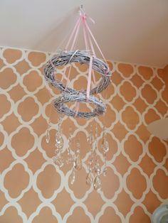 Stenciled wall in nursery - #nurserydesign #accentwall
