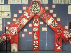 Our own wharenui. Each picture on the maihi represents something important to one student or the class just as the carvings on a meeting house might depict something about the hapu of that marae. On the amo are images of legends that resonate with the class.