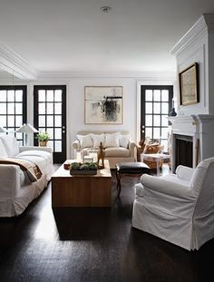I love white walls & furniture with dark wood floors. I could hang in this room.