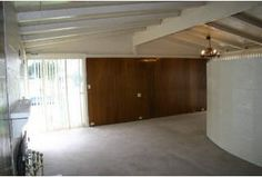 Paneled wall.  Beams are painted white in this home, as they often were over the years.