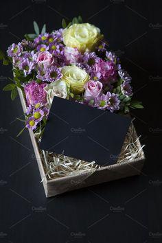 Flowers in a gift box by OlgaPilnik on @creativemarket