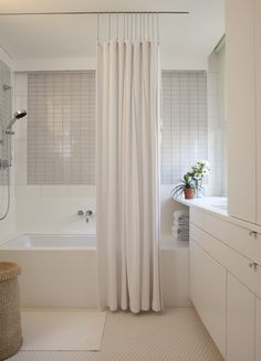 Love ceiling mount shower curtain, excellent for hartwick Excellent use of space in NYC bath; BNOdesign