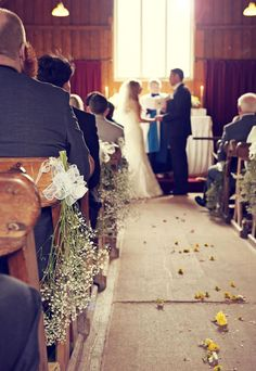 Petals in the aisle. A summer wedding blessing in the Mission Church at Avoncroft Museum of Historic Buildings (avoncroft.org.uk). Rosie Kelly Photography