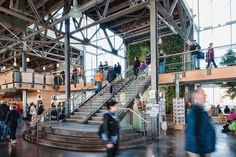 The grand staircase provides a visual focus for the market area. Behind it is a two storey high living wall.
