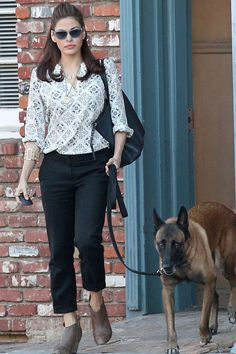"EvaMendes.jpg -- Eva Mendes: Cool dog walker alert! The ""Place Beyond the Pines"" actress looked chic in a pair of cropped slacks, a patterned blouse, and indigo sunglasses, while taking her pooch, Hugo, on a stroll. We're not the only ones who love Eva's style ... Ryan Gosling's girlfriend also participated in Lucky Magazine's FABB: Fashion and Beauty Blog Conference. (10/19/13) Credit: PacificCoastNews"