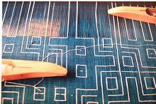 A replica of Pre-Columbian weaving, using cotton in warp and weft. Handdyed with indigo for ground warp and weft. Pattern shows on both sides. Six-shaft loom, using selection rods to get the pattern. Hilde Arts, Belgium.