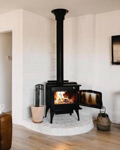UP KNÖRTH — We'll always choose the work of a wood fire over. Wood Stove Decor, Corner Wood Stove, Sweet Home, Cozy House, Home Living Room, Home Interior Design, Home Remodeling, New Homes, House Design