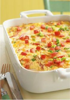 Crustless Bacon & Cheese Quiche – Fresh green onions, mushrooms and tomatoes team up with eggs, bacon, sour cream and cheese for a mouthwatering quiche without the fuss of the crust.