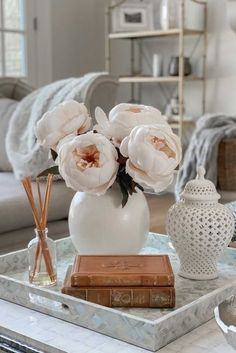Fall is in the air! Bring in the subtle tones of fall to your home decor with a few oversized artificial peony stems. They're the perfect addition to any fall home decor or wedding flower arrangements. Shop artificial peony stems for fall at Afloral.com. Image by @homewithhollyj.
