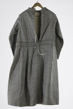 Heavy cotton quilted strong dress worn by agitated or violent female patients in a mental health hospital in Victoria, Australia, circa 1900. The reinforced fabric made destruction of the garment difficult.  Collection: Museum Victoria