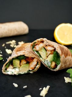Grilled chicken, avocado and spinach wholemeal wrap, a super healthy and tasty meal that can be enjoyed either on the go or when time is short.