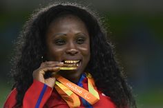 Gold medalist Dalidaivis Rodriguez of Cuba celebrate on the podium at the medal ceremony for the the Women - 63 kg Judo during day 2 of the Rio 2016 Paralympic Games at the Carioca Arena 3 on September 7, 2016 in Rio de Janeiro, Brazil.