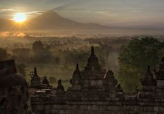 Borobudur Temple - Borobudur Temple Deep within the Kedu Plain, between two volcanoes and two rivers, reigns the world's largest Buddhist temple. Built in the 9th century, the Candi Borobudur in Magelang, Central Java, Indonesia is an architectural feat: six platforms, 504 Buddha statues, and over 1,000 relief panels over three levels that symbolize and illustrate three worlds in the Buddhist cosmology