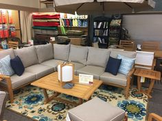 Kingston Casual - Encore Teak Sectional. Sofa, Loveseat, Swivel Lounge, Coffee and Ends as additional items.