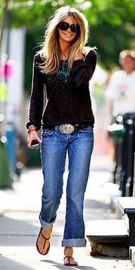 The silver buckle on the belt, rolled up jeans, big sunglasses...great country gal look that works in the city as well. All that's missing? A hat!
