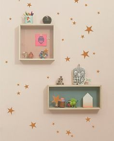 """Easy, adorable wall decals let you change up the look and style of a room in quick minutes...how awesome. <br>• Vinyl<br>• Removable<br>• Color: copper<br>• Can be applied to all even and smooth surfaces<br>• Will not stick to rough surfaces<br>• 49 stars to cut and place as you like<br>• Sheet dimensions: approx 8"""" X 11.5""""<br>• Imported"""