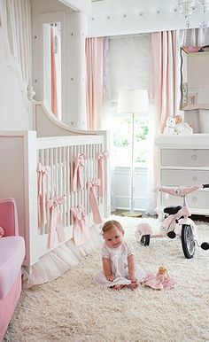 Paint the nursery white, then add colored accents depending on the sex of the baby. Isn't this nursery so classy?