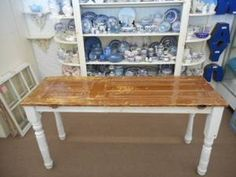 $265 - Antique door bar height table with porch post legs - table has a shellack finish to preserve the chippy paint. ***** In Booth EF at Main Street Antique Mall 7260 E Main St (east of Power RD on MAIN STREET) Mesa Az 85207 **** Open 7 days a week 10:00AM-5:30PM **** Call for more information 480 924 1122 **** We Accept cash, debit, VISA, Mastercard, Discover or American Express