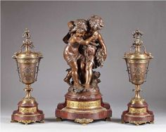 A three piece patinated bronze garniture by Moreau. French, 19th Century.
