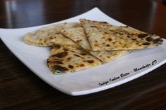 Cheese Naan - Stuffed with cheddar cheese, Jack cheese & cilantro
