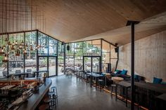 Completed in 2016 in Bridel, Luxembourg. Images by Steve Troes . In place of the old bar/restaurant BOOS Beach Club, modern and contemporary architecture, tightly linked to its context, reflects the new image of. Modern Restaurant, Restaurant Design, Restaurant Bar, Restaurant Exterior, Beach Club, Origami Architecture, Interior Architecture, Interior Design, Contemporary Home Decor