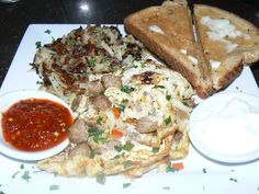 Fritomelet with Turkey Sausage, Jalapeno, Onion,Red Pepper, Mushrooms, and Smoked Gruyere Cheese. Onion Hash Browns, Toast. | Yelp