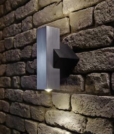 This LED up and down exterior wall washer varies from the usual. It is chunky, angular and the contrasting black and silver finish makes it really stand out. Garden Exterior Lighting, Exterior Wall Light, Wall Wash Lighting, Wall Lights, London Garden, Modern Exterior, Outdoor Lighting, Compact, Silver