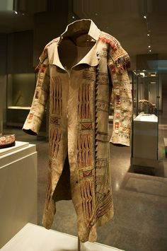 Coat, ca. 1789   Ojibwa   Geographic Origin: Ontario, Canada  Native leather, rawhide, pigment, porcupine quills, glass beads and deer hair