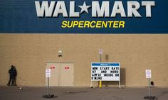 A man stands on a skateboard outside a Wal-Mart store in Williston, North Dakota March REUTERS/Shannon Stapleton