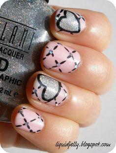 Uñas en rosa pastel decoradas con corazones y líneas discontinuas - Uñas Pasión