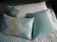 Jenny tells how she put the binding on the pillows as she quilted them on her long arm.  I'm going to have to try it.  Cute pillows and texture, too.