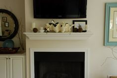Ah hah!  How to decorate a mantle with an obnoxious TV over it!
