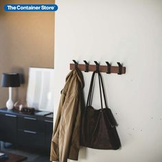 This Japanese-designed wall rack includes five movable hooks so you can customize the look and the capacity. Slide hooks off and on. Reposition them as needed. Since items can hang from the top and bottom of each hook, there's room for coats, jackets, caps, umbrellas, handbags, leashes and more. A natural addition to an entryway, this sleek wall-mounted coat rack can easily double as an accessory organizer for closets. Wall Mounted Coat Rack, Wall Racks, Coat Hooks, Reach In Closet, Entryway Organization, Container Store, Umbrellas, Closets, House Design