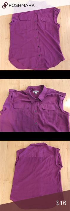 Calvin Klein button down fuchsia top size large Polyester Calvin Klein button down top with breast pockets size large in fuchsia purple pink color. Bust: 44 inches. Length: 28 inches. Calvin Klein Tops Button Down Shirts
