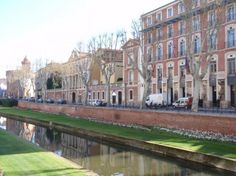 Perpignan, France.  2 hours from Barcelona.  Day trip?