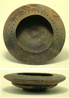 The earthenware vessel with the design of the hole.   Jomon period. Gunma Japan.  BC.5,000 - BC.3,500.