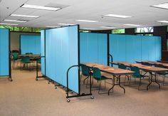 The ability to temporarily divide space is an important part of having a flexible space.  Portable room dividers can provide the privacy you need during group functions. #portablepartition #temporarywall #roomdivider