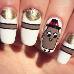Chubby Turkey  Golden moons, brown stripes and an adorable little turkey (with a hat!) make this the perfect mani for Thanksgiving.