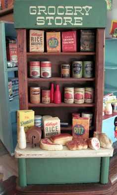 Vintage dollhouse grocery store display.
