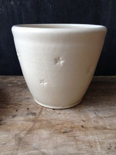 Small white glazed stoneware planter and saucer set, with stars